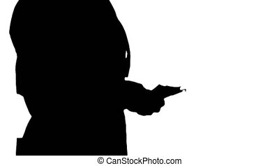 Silhouette A woman in a workers clothes counts money. -...