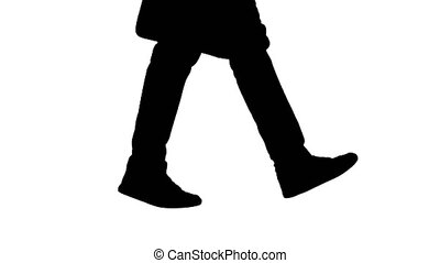 Silhouette Mans feet is walking in jeans and sneakers. -...