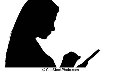 Silhouette Pleasant woman using tablet. - Close up side...
