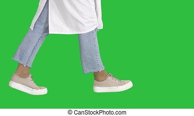 Woman doctor legs walking on a Green Screen, Chroma Key.