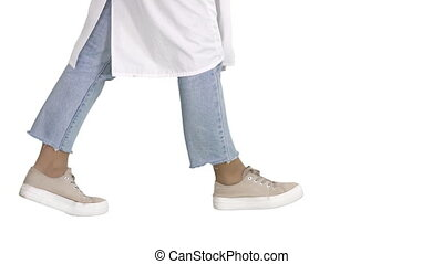 Close up. Side view. Woman doctor legs walking on white background. Professional shot in 4K resolution. 006. You can use it e.g. in your commercial video, business, presentation, broadcast