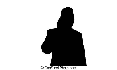 Silhouette Businessman talking on mobile phone happily.