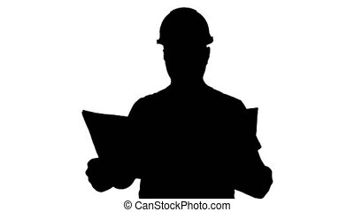 Silhouette Engineer or Architect or Construction Worker holding blueprint and looking in the result of the work.