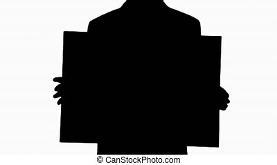 Silhouette Man in suit holding a blank board.