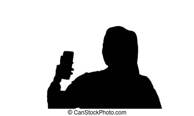 Silhouette Smiling young woman taking a selfie smiling -...