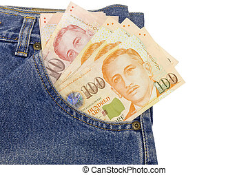 Close up Singapore dollars in a jeans pocket isolated on white background, clipping path
