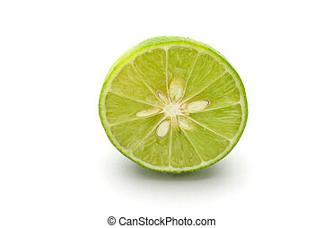 close up slice of fresh lime isolated on white background