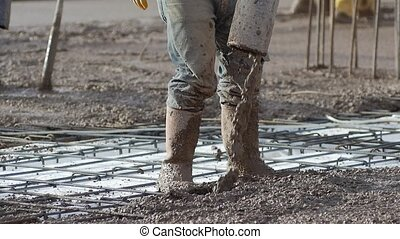 Close up, Slow Motion. Construction worker controls the...