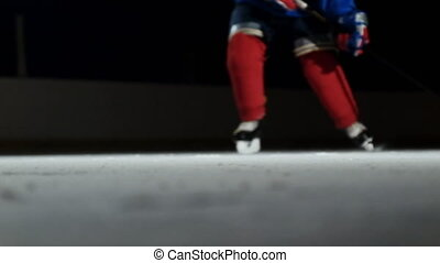Close-up slow motion hockey puck and flying snow, hockey...