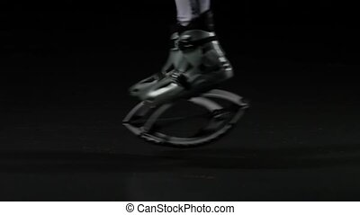 Close-up slow motion, legs jumping in jump shoes.