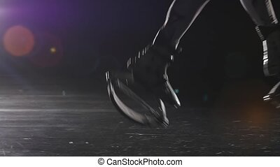 Close-up slow motion of legs jumping in jump shoes against spotlight