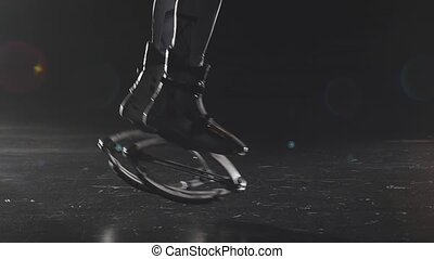 Close-up slow motion of legs jumping in jump shoes.