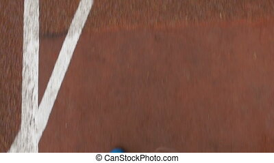 Close-up slow motion pov of a sportsman feet running on a course track