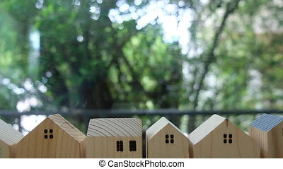 Close up small wooden house of village. Real estate home mortgage or buying concept. Business financial and loan. Dolly shot panning.