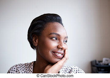 Close up smiling african american woman leaning with head in hand