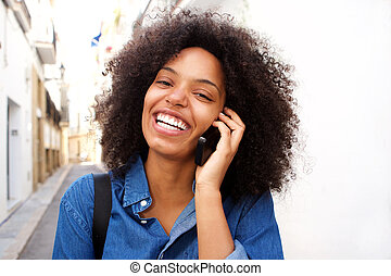 Close up smiling african american woman talking on smart phone