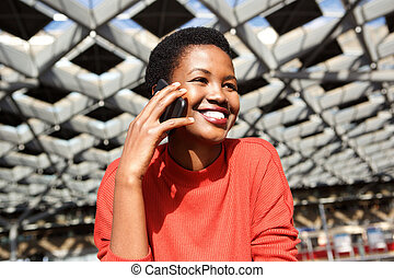 Close up smiling african american woman talking with cellphone