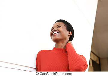 Close up smiling african american woman with hand behind head