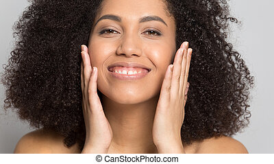 Close up smiling african american woman with perfect skin.