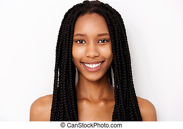 Close up smiling african american young woman with braids on white background