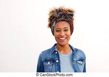 Close up smiling black woman wearing headscarf standing against white background