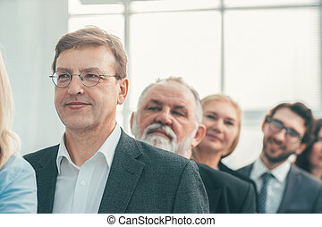 close up. smiling business people standing in a row.
