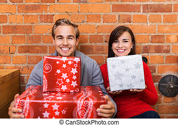Close up Smiling Couple Holding Gift Boxes