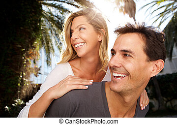 Close up smiling couple in love outside in embrace