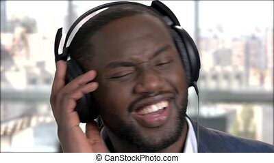 Close up smiling face of businessman in headphones.