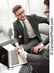 close up. smiling lawyer gives his business card to businessman