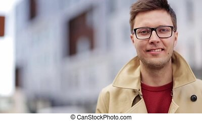 close up smiling man in eyeglasses outdoors - emotion,...