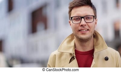 close up smiling man in eyeglasses outdoors - emotion,...