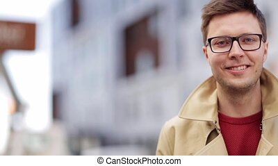 close up smiling man in eyeglasses outdoors