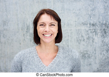 Close up smiling middle aged woman