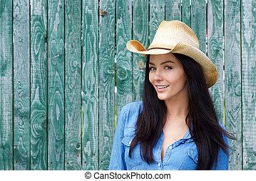 Close up smiling woman wearing cowboy hat