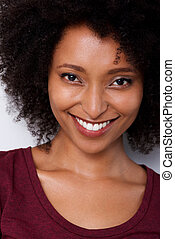 Close up smiling young african american woman with curly hair
