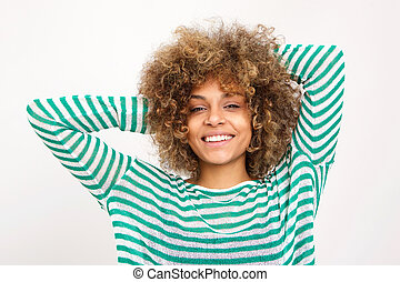 Close up smiling young african american woman with hands in hair against white background