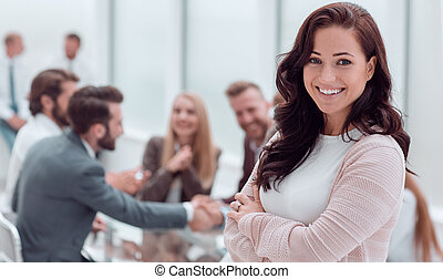 close up. smiling young business woman standing in office