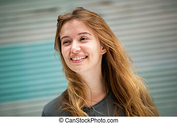 Close up smiling young woman looking away