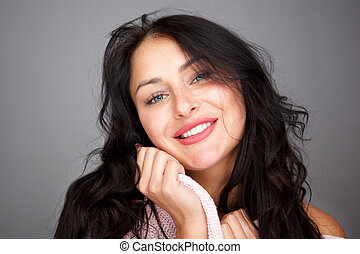 Close up smiling young woman with healthy long hair