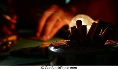 smoking cigarette in workshop - close up smoking cigarette...