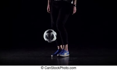 Close-up soccer player's legs making tricks with ball. Slow...
