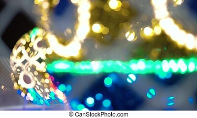 Close-up - Sparkles And Garlands Shine And Are Reflected By...