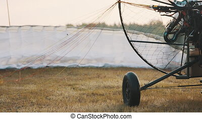 Close up. Spinning propeller of the tandem paramotor. Getting ready to fly off. Parachute in the background. High quality 4k footage