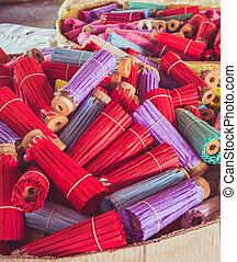 Close up stack of colorful handmade umbrella in Chiang Mai, Thailand