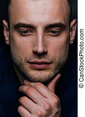 Close-up Studio portrait of young sexy man face hand-touch ,...