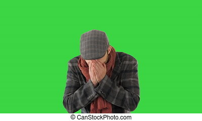Stylish gentleman walking and coughing on a Green Screen, Chroma Key.