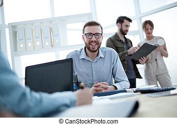 successful confident businessman sitting at his Desk