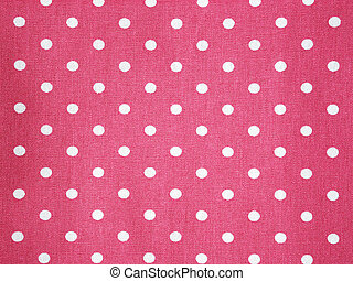 pink cotton fabric with white polka dot pattern background.