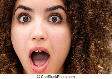 Close up surprised young woman with mouth wide open